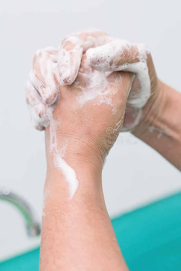 Nurse perform surgical hand washing, Preparation to the operating room. Closed-up of the hands. royalty free stock image