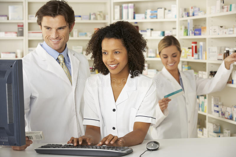 Nurse and pharmacists working in pharmacy stock photos