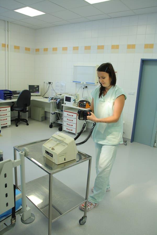 Hospital Emergency Room: Nurse Prepare Heart Defibrillator Stock Photo