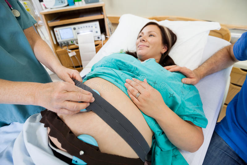 Nurse Preparing Pregnant Woman For Heartbeat royalty free stock photography