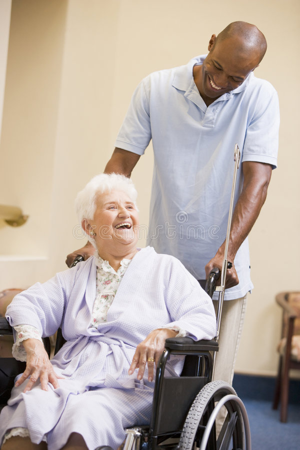 Free Nurse Pushing Senior Woman In Wheelchair Stock Image - 6428101