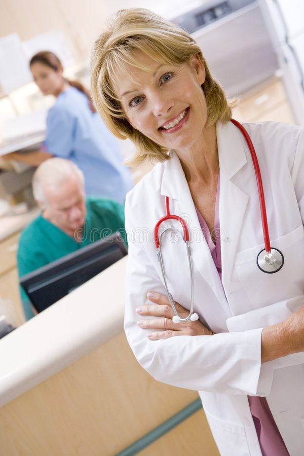 Nurse In The Reception Area Of A Hospital. A Doctor And Nurses In The Reception Area Of A Hospital royalty free stock image