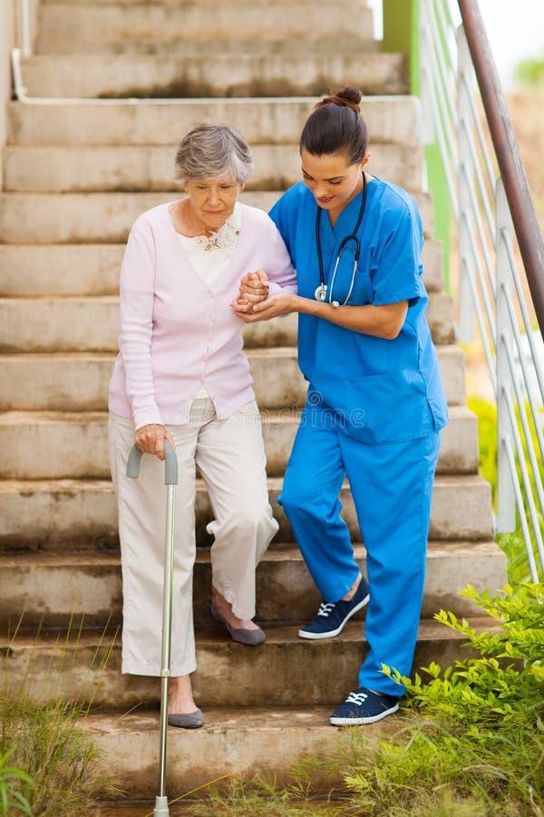 Nurse senior stairs royalty free stock images