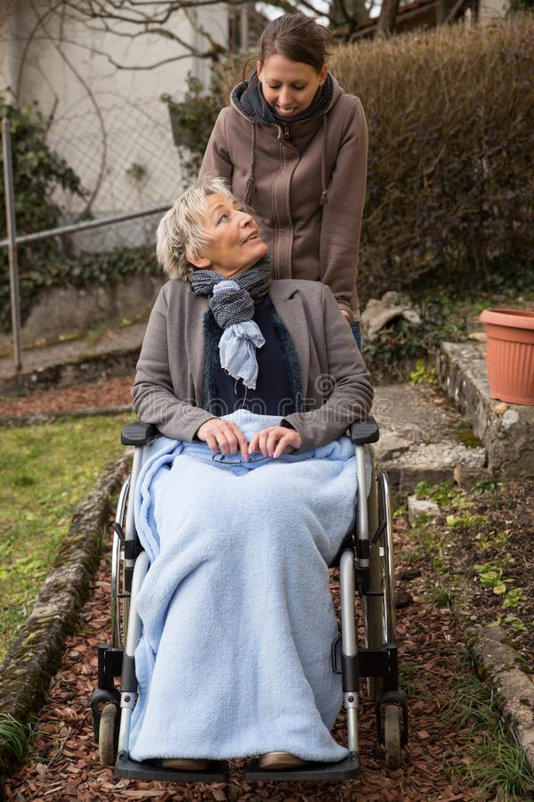 Nurse and senior in wheelchair royalty free stock photography