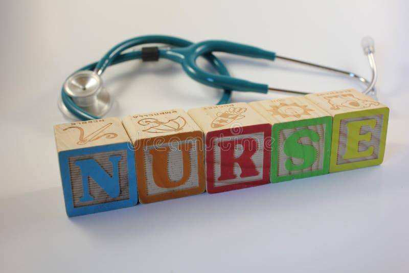 Nurse Spelled on Blocks with Stethoscope royalty free stock photo