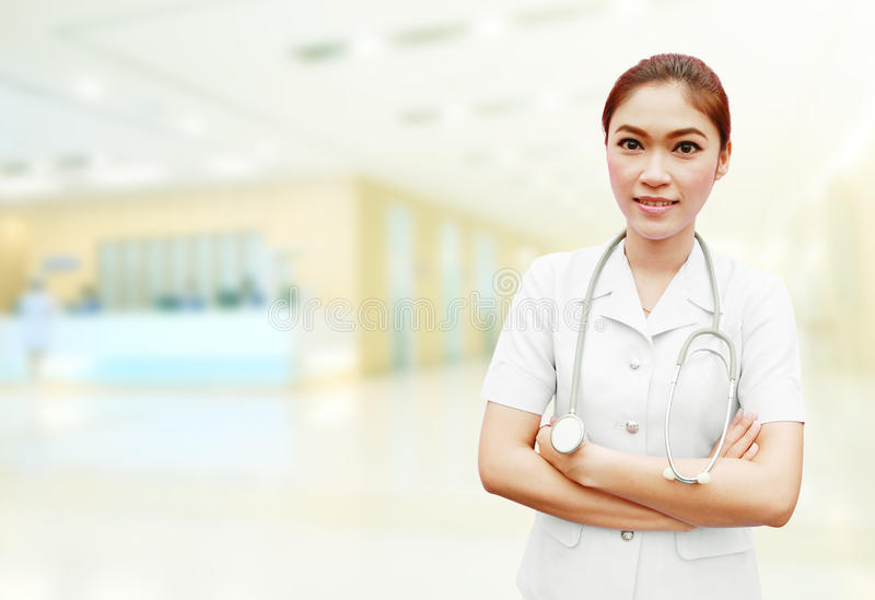 Nurse with stethoscope in hospital stock photo
