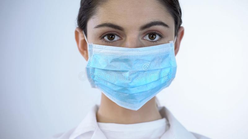 Nurse in surgical mask close-up, epidemic prevention, awareness of disease stock photos