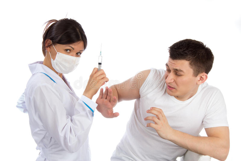 Nurse syringe needle and man scary of injection vaccination phobia. Doctor or nurse with syringe needle and men scary of injection vaccination phobia concept stock photos