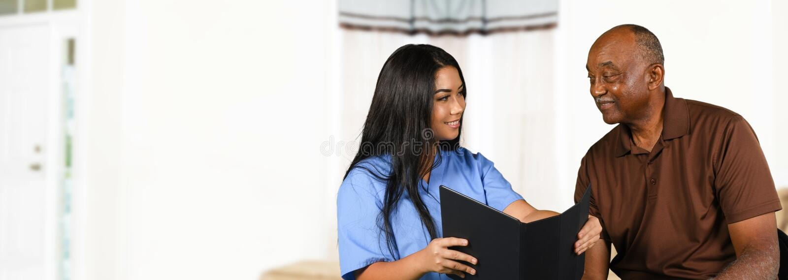 Nurse Taking Care of Senior. Nurse who is working her shift taking care of a patient stock images