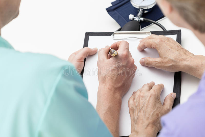 Nurse taking notes stock photos