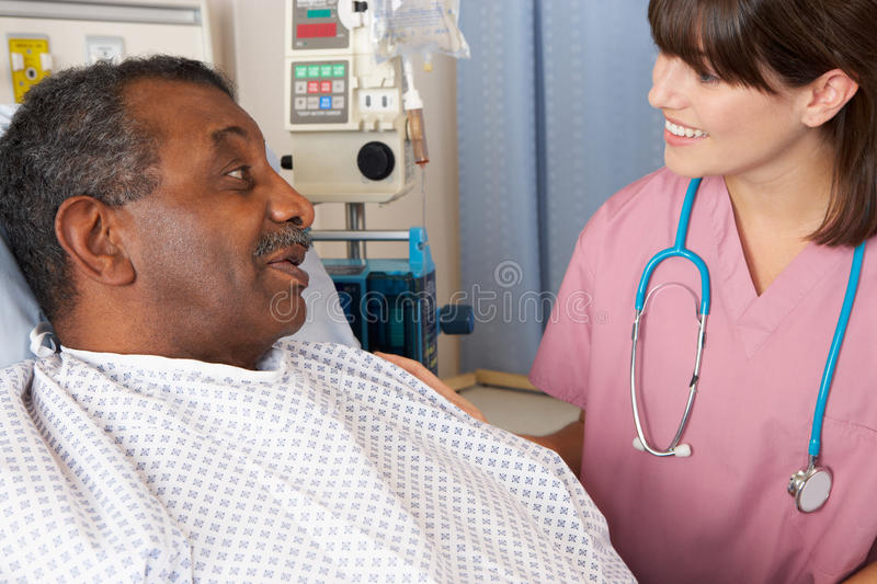 Nurse Talking To Senior Male Patient On Ward royalty free stock image