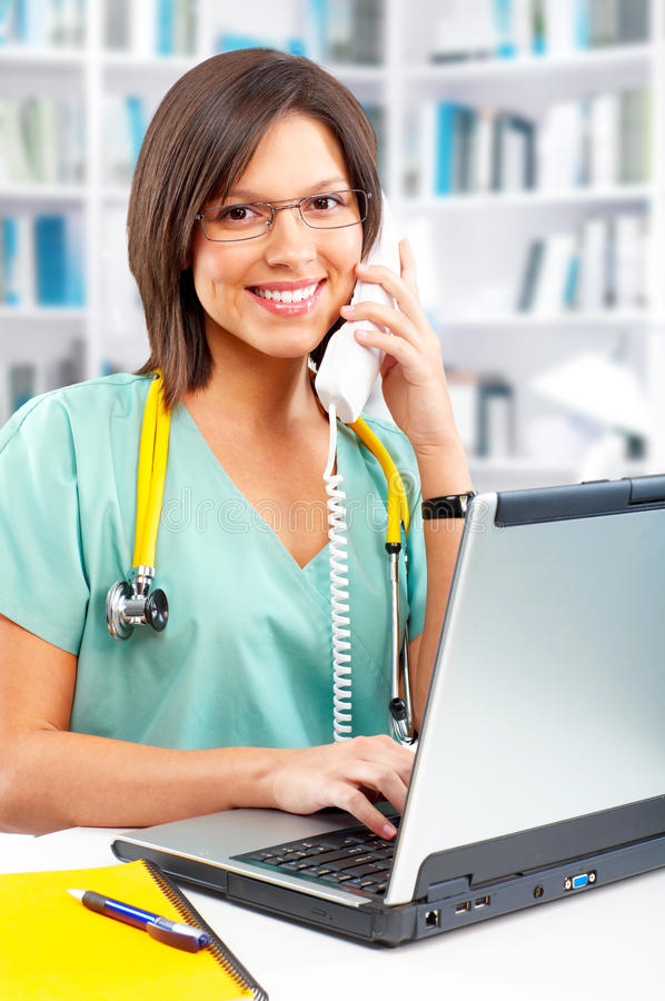 Nurse With Telephone And Laptop Stock Photo