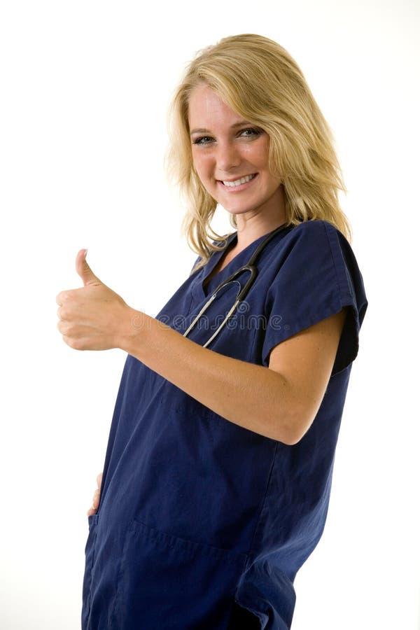 Nurse thumbs up stock photography
