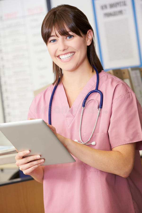 Nurse Using Digital Tablet At Nurses Station royalty free stock photography