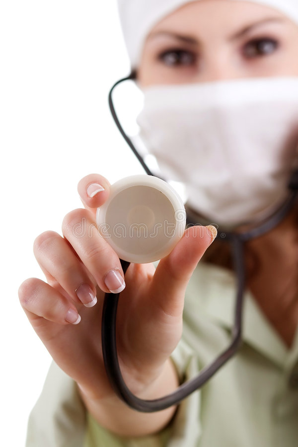 Nurse in white mask. An image of a nurse in white mask with stethoscope stock photography