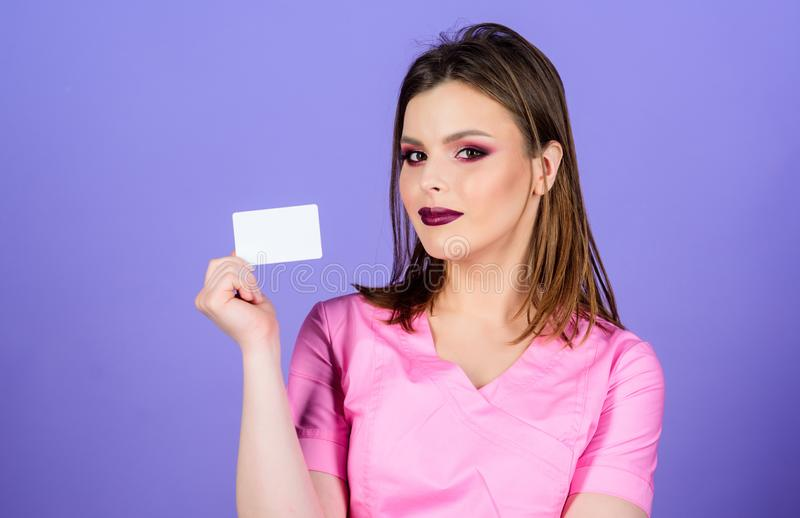 Nurse in white uniform hold business card. sexy woman doctor. health care and medical concept. Doctor. Health care and royalty free stock photos
