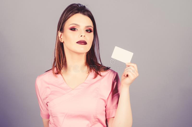 Nurse in white uniform hold business card. sexy woman doctor. health care and medical concept. Doctor and patient stock photos