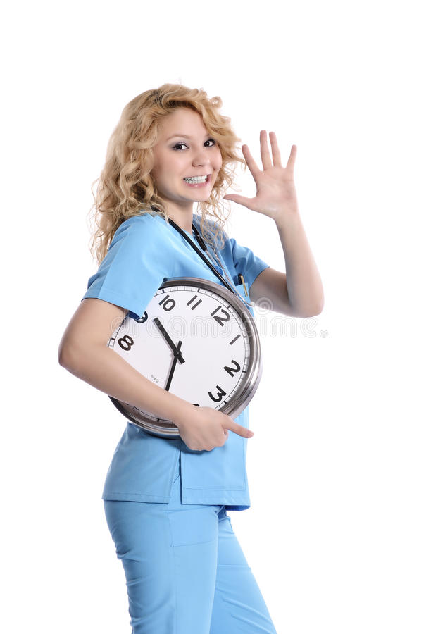 Nurse woman running late. With clock under her arm. Healthcare concept photo with young worker in a hurry running against time. Caucasian model isolated on stock image