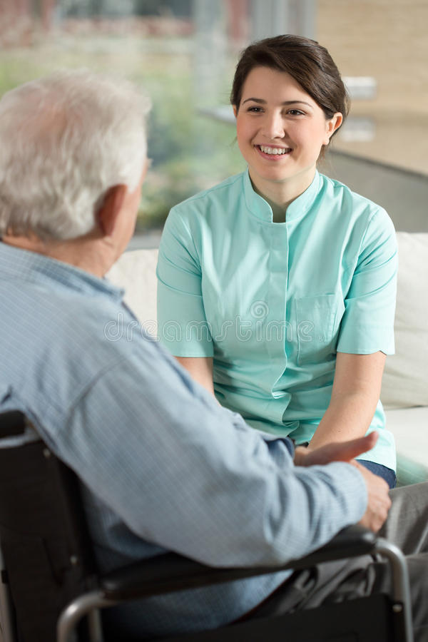 Nurse working at retirement home. Image of nurse working at retirement home stock image