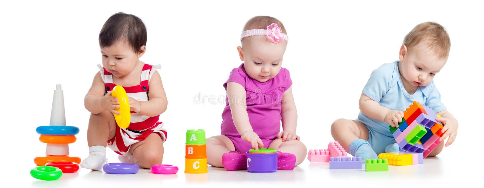 Nursery babies with educational toys. On white stock images