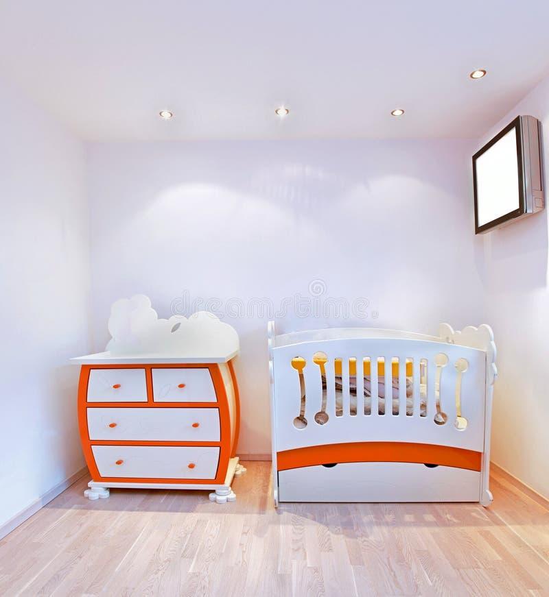 Nursery detail. Detail of nursery room interior with small crib stock image