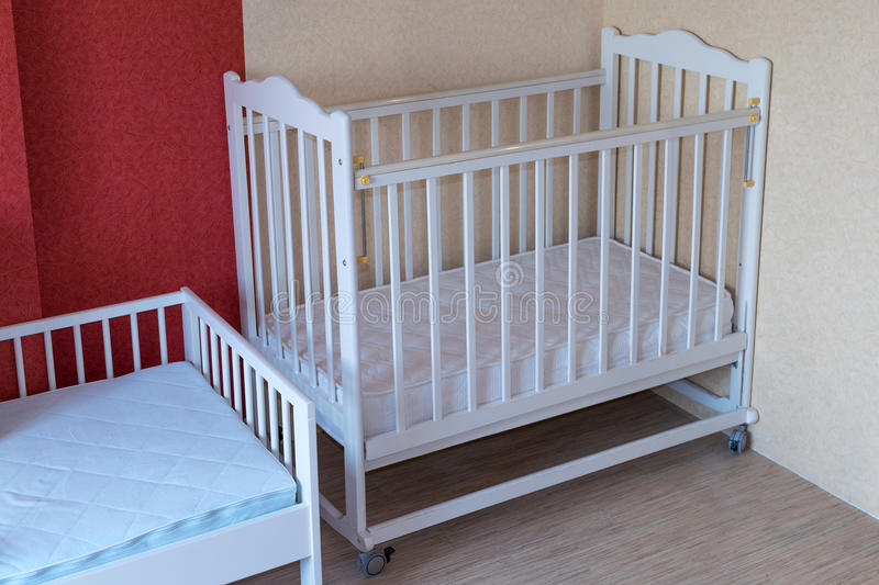 The nursery has two Cribs. One cot for toddlers and one for older children. royalty free stock photography