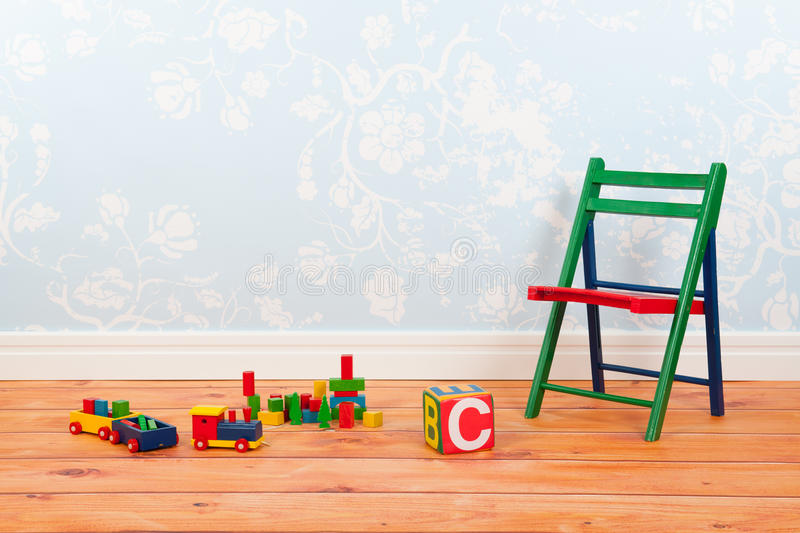 Nursery room with blue vintage wall paper and toys stock photo