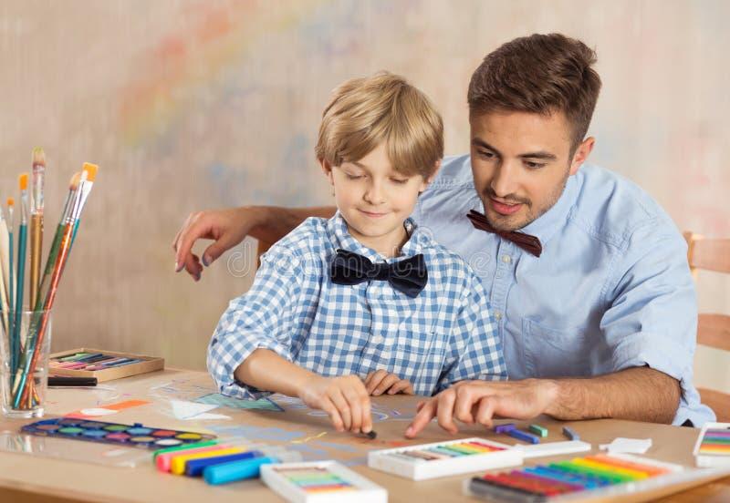 Nursery teacher and child stock image