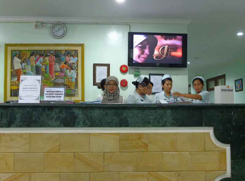 Nurses at hospital reception. Asian nurses at hospital reception, Bali, Indonesia royalty free stock photo