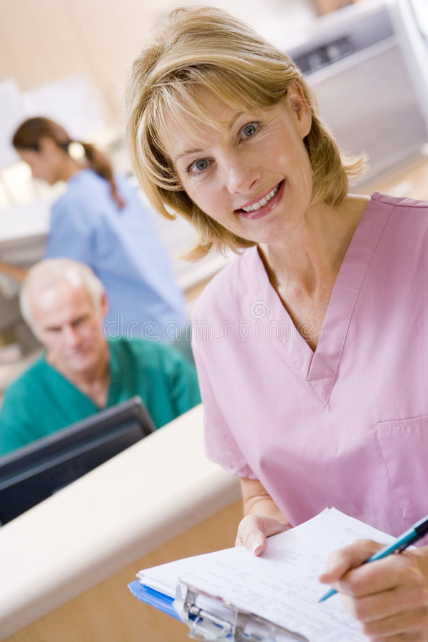 Nurses In The Reception Area Of A Hospital. Smiling royalty free stock image