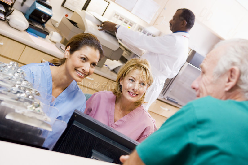 Nurses Talking At The Reception Area In A Hospital. Smiling royalty free stock image