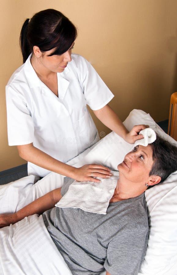 Download Nurses wash a patient stock image. Image of department - 14182791
