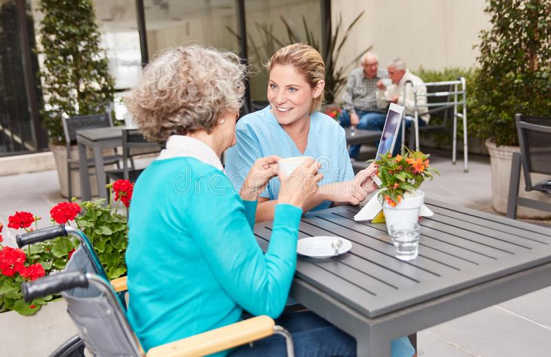 Nursing help in conversation with a senior citizen in a nursing home royalty free stock photography