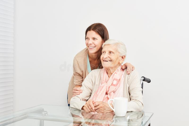 Nursing help makes home visit with old seniors stock photo
