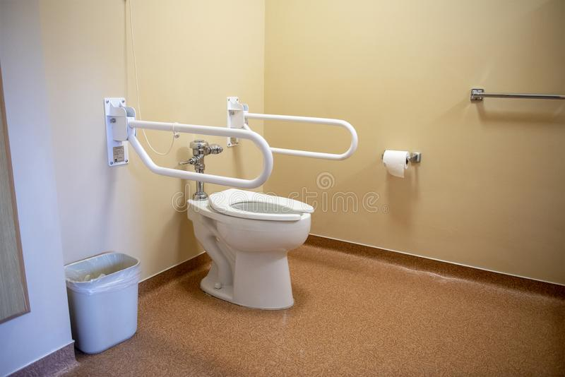Nursing Home, Assisted Living, Bathroom, Hospital, Toilet. Bathroom toilet in a nursing home or assisted living facility or medical healthcare hospital. The stock images
