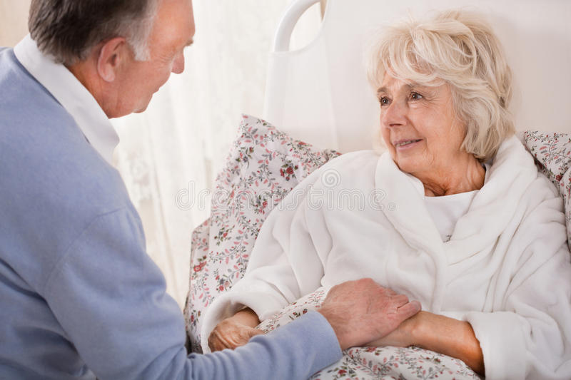 Nursing ill wife royalty free stock images