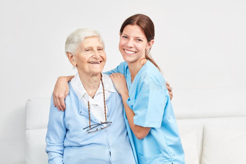 Nursing wife and happy elderly woman royalty free stock photography