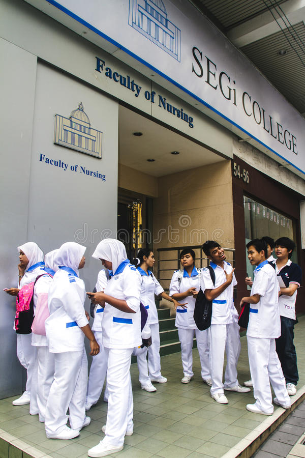 Nursing students in front of school stock photos