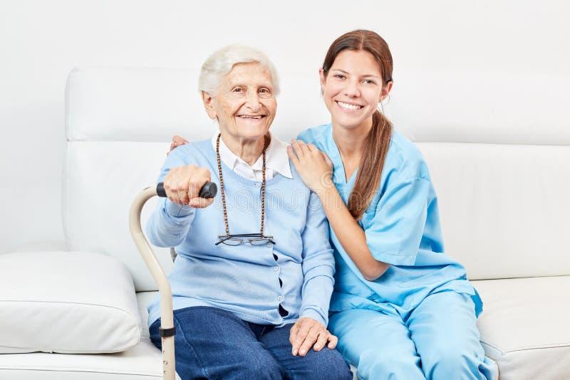 Nursing wife and happy elderly woman royalty free stock photos