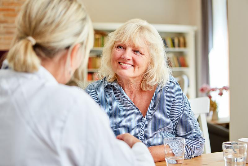 Nursing wife and senior home visit royalty free stock image