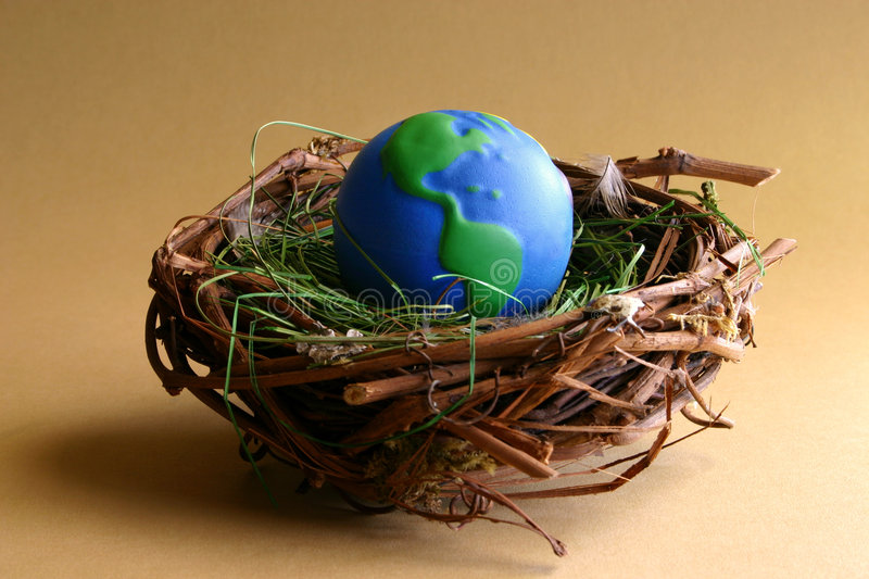 Nurturing Earth. A globe sits in a lined nest. Conceptual image to represent conservation, the environment, population growth, protecting the earth, etc