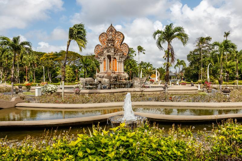 Nusa Dua area with buildings and fountains in traditional Balinese style, Bali, Indonesia.  royalty free stock images