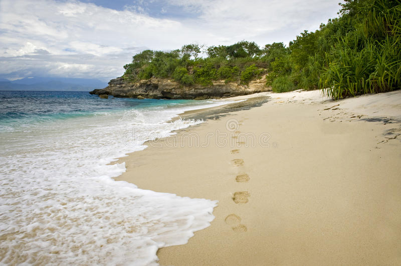 Nusa Lembongan, Bali. A beautiful, isolated sandy beach on the nearby island of Nusa Lembongan. Footprints mark the only evidence of habitation stock images