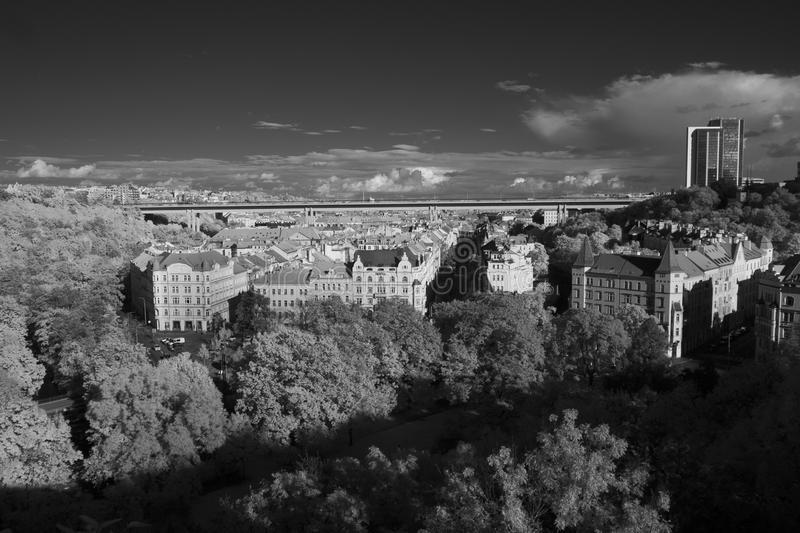 Nuselsky Bridge above the streets of Nusle, Prague, Czech Republic. Infrared view of Nusle residential area with Nusle Bridge above it (taken with stock image