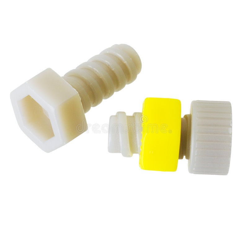 Nut and bolt. Grey nut's and yellow bolt on the white background stock photos