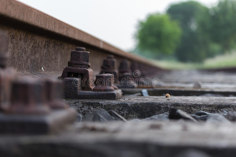 Nut and bolt on railway track royalty free stock images