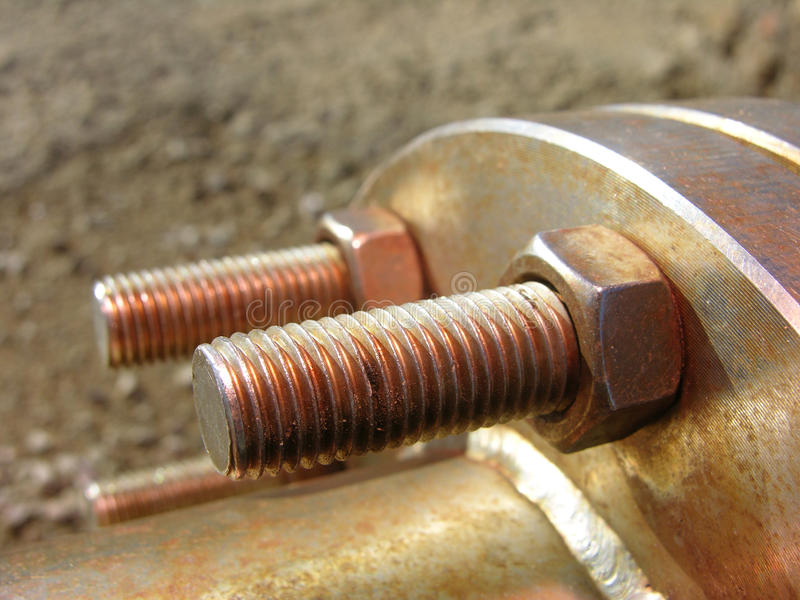 Nut and bolt. Always tighten the components with nut and bolt royalty free stock photos