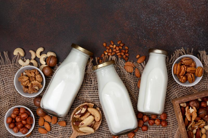 Nut milk in glass bottles royalty free stock image