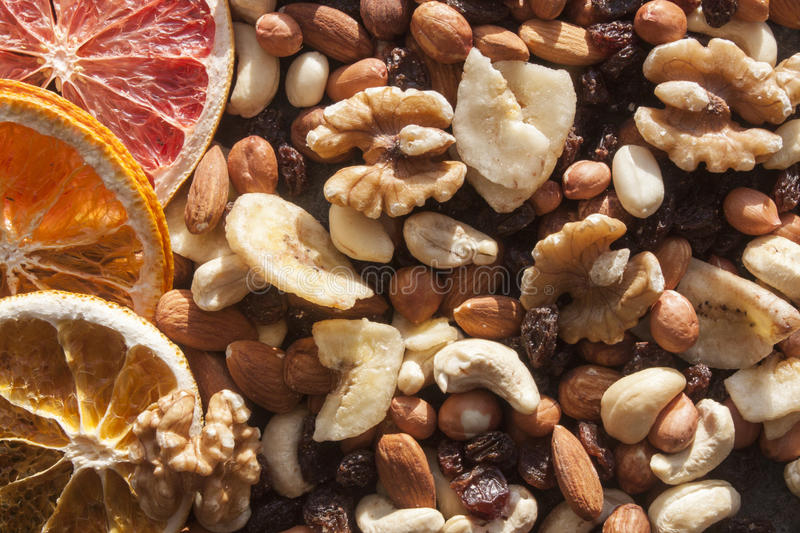 Nut mix and dry fruits. Cashew nuts, walnuts, hazenuts, almonds, dry orange and dry grapefruits royalty free stock photos