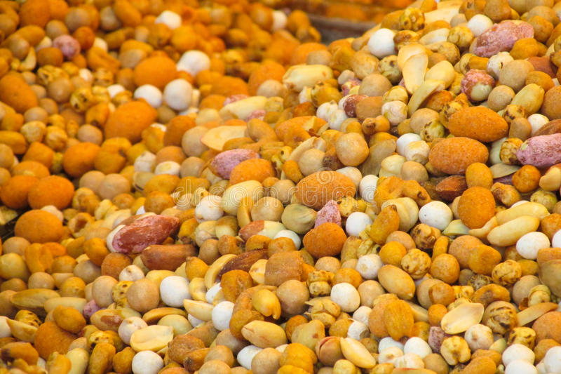 Nut mix pattern. Lots of nuts sold at the food market stock images